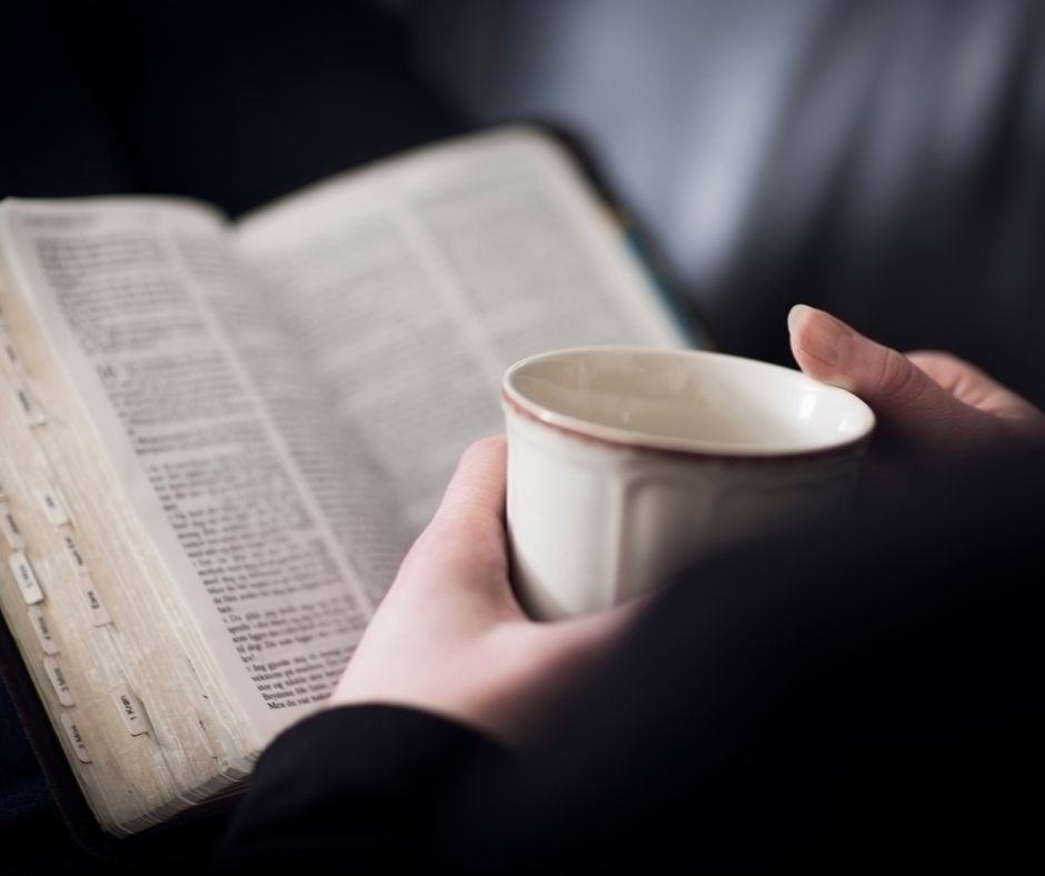 woman studying the Bible with a cup of coffee