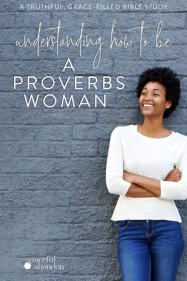 "smiling woman against a brick wall with text ""understanding how to be a Proverbs woman"" a truthful, grace-soaked Bible study by Graceful Abandon."