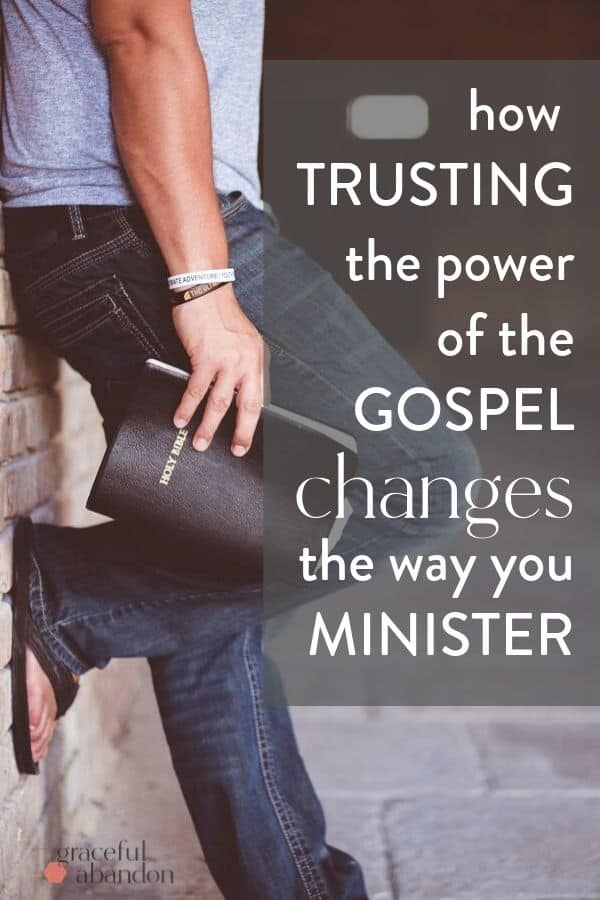 "a hand holding a bible and leaning against a brick wall with text ""how trusting the power of the Gospel changes the way you minister"" by Graceful Abandon"