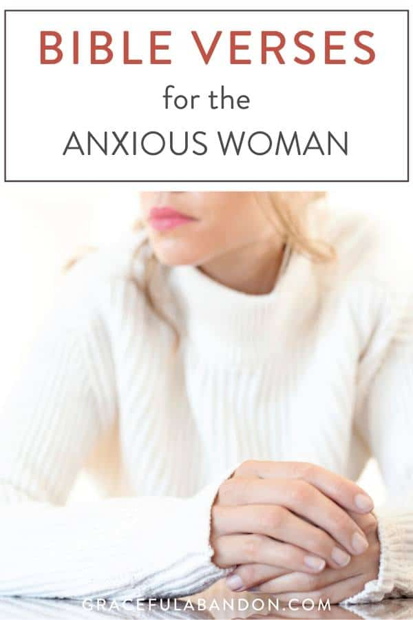 woman clenching hands with anxiety