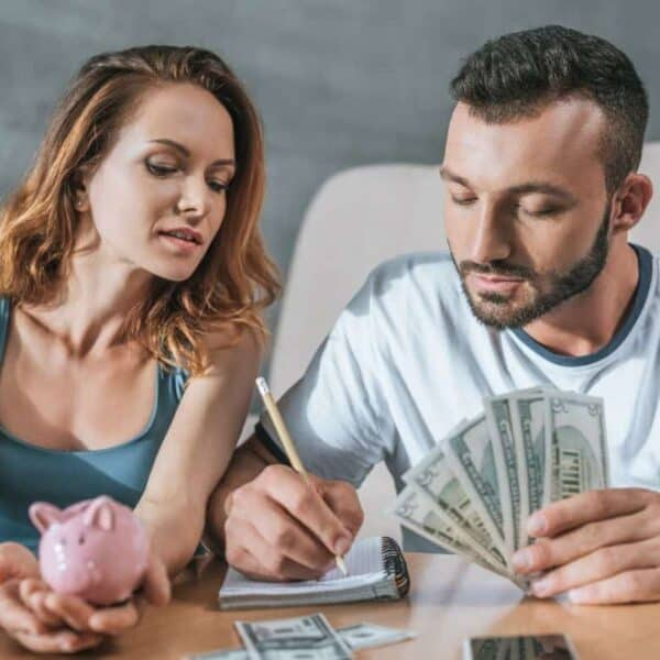christian married couple counting money and managing finances together