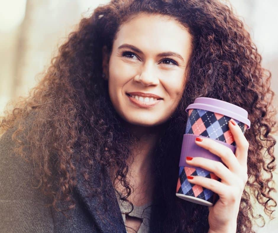 happy daughter of God holding coffee