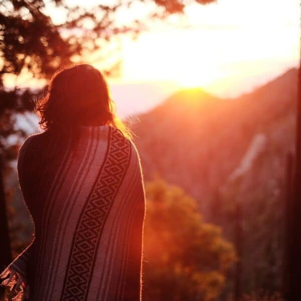 woman watching sunrise, contemplate fulfilling your purpose
