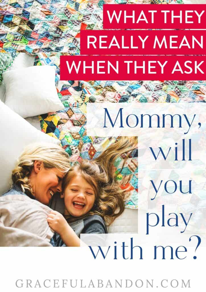 mom and daughter on a quilt laughing with text overlay: 'What they really mean when they ask Mommy will you play with me?' by Graceful Abandon
