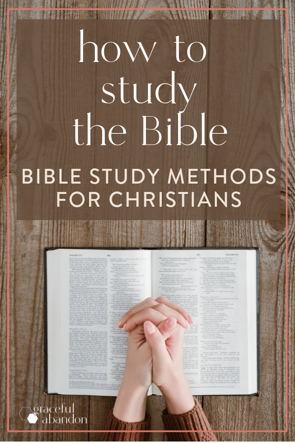 "Bible with praying hands on a wooden table with text overlay ""how to study the Bible: bible study methods for Christians"""