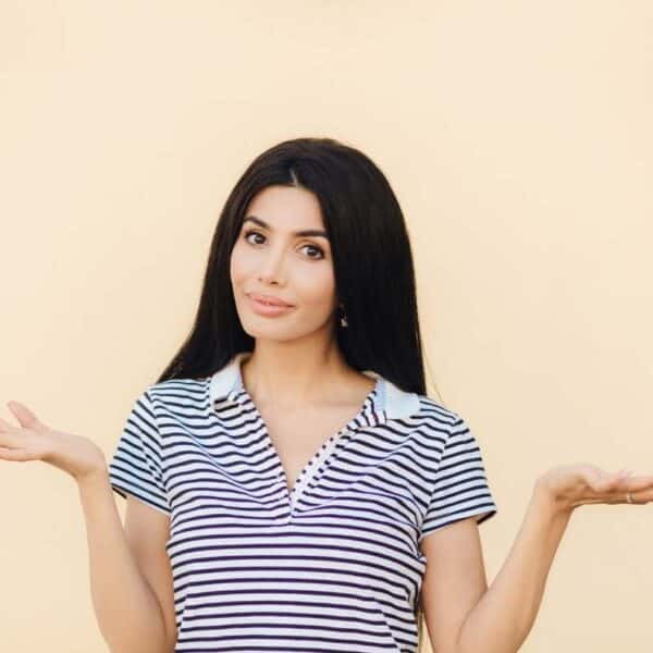 woman confused in times of uncertainty with hands in question pose