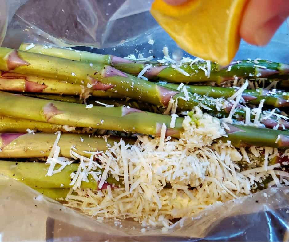 marinating oven roasted asparagus with lemon, garlic, and parmesan
