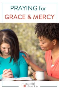 two women praying for God's grace and mercy